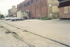 Tom Burke Collection Milwaukee Road Chicago & Evanston (C&E) Line Reed Candy Lakewood Fletcher Sep. 1980 (Tom J. Burke) Tags: chicago reedcandy milwaukeeroad railroad streettrackage spur bumpingpost hopper tankcar lakeview lakewood