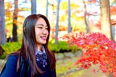 Beautiful Girl at Gotokuji (Dakiny) Tags: 2017 winter december japan tokyo setagayaward gotokuji city street temple gotokujitemple autumnleaves autumncolors maple red bokeh