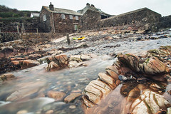 Port Quin Harbour II (Christian Hacker) Tags: portquin cornwall cornish harbour longexposure stonebuildings derelict abandonded hamlet stream water blurred blur movement pebbles rocks rocky stones yellowkajak house buildings canon tamron landscape autumn british seaweed kelp pole low angle shutter speed overcast explore explored