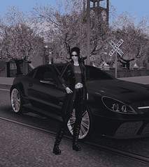 Excellent Vintage (alexandriabrangwin) Tags: alexandriabrangwin secondlife 3d cgi computer graphics virtual world photography mercedesbenz amg sl65 v12 twin turbo car black street pose vintage image style standing parked across woman front sunglesses leather jacket long coat laced boots ponytail