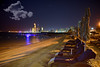 Abu Dhabi Downtown Front At Night (Shedraway Photos) Tags: abudhabi night beach beachfront skyscrapers stars cloud beachumbrellas cityinlight lights abudhabiatnight unitedarabemirates canon6d