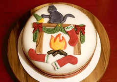 Christmas Cake A, 2017 (devoutly_evasive) Tags: cake decorated fruitcake christmas xmas fondant iced icing cat grey naughty bad stockings fireplace fire mantel mantle knocking breaking deviant mog kitty
