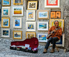 Making some money (Inky-NL) Tags: ingridsiemons©2017 colorful straatmuzikant guitar 2017 italie september vakantie guitarist gitarist paintings schilderijen money muziek music lakegarda gardameer malcesine italy italia street streetphotography