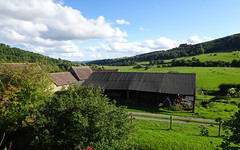 Farmbuildings behind Stokesay Castle (Dunnock_D) Tags: uk unitedkingdom britain england shropshire stokesay blue sky white clouds green grass trees fields