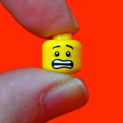 Feeling the Squeeze (linda_lou2) Tags: macromondays fingertips macro 60mm lego minfigure minifig face squeezed fingers selfie squarecrop