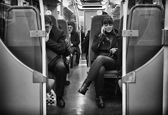 Journey on a train (Rico Shay) Tags: peoplewatching people transport travel train blackandwhite trainjourney technology