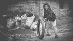 Boy and Tyre (#Weybridge Photographer) Tags: canon slr dslr eos 5d mk ii nepal kathmandu asia mkii phutung monochrome boy child tyre tire