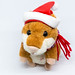Hamster doll clad like Santa Claus