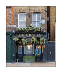 The Grapes, East London, England. (Joseph O'Malley64) Tags: thegrapes pub publichouse georgianbuilding georgianera georgianbritain survivingbuilding limehouse eastlondon eastend london england uk britain british greatbritain architecture architectural architecturalfeatures architecturalphotography georgianlondon brickwork bricksmortar cement pointing londonbrick mitredbricklintels redbrick sashwindows acidetchedwindows castironsignmount streetsign redundanttelephonewiring blueplaque burglaralarm airconditioner securityspikes windowboxes hangingbaskets stucco stuccowork mouldings battenmouldings bollard bucket lamps lighting signs signage glazedtiles doors doorways woodenglassdoors entrances exits steelsecuritydoors concrete stopcock beercellardoors wiring electricalwiring urban urbanlandscape fujix x100t accuracyprecision thewrathofthegrapes
