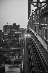 Transit of a train (Valley Imagery) Tags: philadelphia train bridge city a99ii usa black white bw contrast