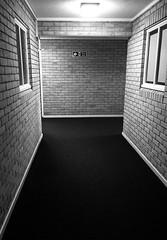 Corridor (Number Johnny 5) Tags: angles lines interior space empty blackandwhite bnw white black adorenoir noir corridor iphone
