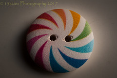 Button of Colour (HMM) (13skies) Tags: buttonsandbows monday colours round theme pinwheel macromondays macro macromonday close sonyalpha100 windowlight happymacromonday holes small colors