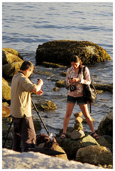 Photographer and Assistant (HereInVancouver) Tags: photographer photographyassistant candid streetphotography rocks ocean pacific seawall englishbay stanleypark vancouver bc canada canong16 thingstodobythewater