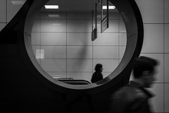 two sides of the story / a reflection so very fainted (Özgür Gürgey) Tags: 2017 50mm bw d750 nikon vezneciler architecture blur candid grainy hole motion people reflection station street subway istanbul