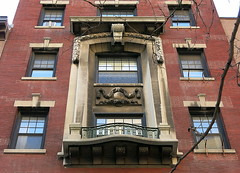 """A """"prominent"""" two-story window frame with balcony, 12 Fifth Avenue (1910), Greenwich Village, New York (Spencer Means) Tags: balcón balkon balcony window architecture building apartment stone carved carving molding moulding lower fifth 5th avenue street facade façade 12 greenwichvillage newyork city nyc ny urban neighborhood"""