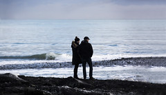 Standing on the beach (Alex Szymanek) Tags: beach ice water waves iceland cold look standing silhouette reflects horizon two simple people view frozen