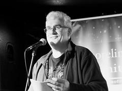 Shoreline of Infinity November - Andrew J Wilson 02 (byronv2) Tags: edinburgh edimbourg scotland literature sciencefiction bansheelabyrinth pub bar reading books peoplewatching candid oldtown shorelineofinfinity portrait author writer poet man andrewjwilson blackandwhite bw monochrome
