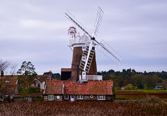 The Windmill (rustyruth1959) Tags: nikon nikond5600 tamron16300mm uk england eastanglia norfolk cleynextthesea cleywindmill windmill sails windmillsails cap windmillcap cleyharbour reeds marsh silt building tower structure fantail windows houses roof rooftiles rooftops outdoor landscape chimneys cottages trees millstones mill stage railings