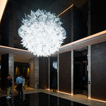 A super big ball light, there is gorgeous chandelier light in elevator hall.