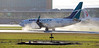 C-FWSY (kentmatthiesen) Tags: westjet boeing 7377ct cfwsy reverse thrust cyvr