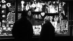 festive market at night 02 (byronv2) Tags: edinburgh edinburghbynight night nuit nacht festivemarket christmasmarket market princesstreetgardens princesstreet mound newtown blackandwhite blackwhite bw monochrome peoplewatching candid street winter stall shop shopping