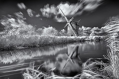 Seen better days (David Feuerhelm) Tags: blackandwhite monochrome bw noiretblanc schwarzundweiss contrast reflection wideangle longexposure windmill windpump old history historic ruin cloud water infrared silverefex nikon d90 sigma1020mm