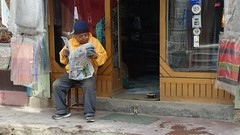Catching up on world events (posterboy2007) Tags: kathmandu nepal nepali newspaper street man sony rx100m3