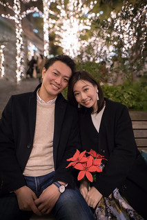 Portrait of lovely couple in Christmas lights