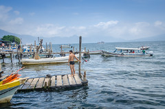 Panajachel boat dock (Pejasar) Tags: 2015 guatemala college mission lakeattitlán boatdock blue men boats lake dock tree