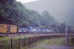 Conrail SD45 #6185 helps push a train thru the Curve on 7-13--79 (LE_Irvin) Tags: caboose conrail horseshoecurve sd45