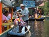 Flower seller in Xochimilco (nickdippie) Tags: mexico xochimilco ciudaddemexico canal boat canalboat gondolier colourful flowers garland