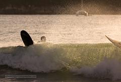Surfers at sunset. Nai Harn beach, Phuket island, Thailand (Phuketian.S) Tags: people surfing surfer qave droplet phuket thailand naiharn tropic sea water sport jump action fun holiday relax beach yacht catamaran phuketian rock nature landscape