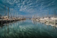 Sailboats in La Grande-Motte (justenoughfocus) Tags: boats france lagrandemotte montpellier water clouds europe harbor landscapephotography mediterranean reflection reflections sailboats waterfront locations languedocroussillon fr
