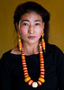 Portrait of a tibetan woman with a huge necklace, Qinghai province, Tsekhog, China (Eric Lafforgue) Tags: 2530years 30s adorned amdo asia asian asianethnicity beautifulpeople china china17359 colourimage ethnic ethnicity frontview headshot huangnan jewel jewellery jewlery lookingatcamera necklace oneadultonly onepersononly onewomanonly ornament ornamental ornate ornated people portrait posing qinghaiprovince tibet tibetan tibetanautonomousprefecture tongren traditionalclothing travel tsekhog vertical women worldtravel yellowbackground zekog chn