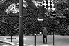With the plaid shirt (pascalcolin1) Tags: paris13 homme man mur wall lignes lines carreaux tiles plaidshirt chemiseàcarreaux photoderue streetview urbanarte noiretblanc blackandwhite photopascalcolin 50mm canon50mm canon