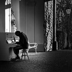 pianoplayer (heinzkren) Tags: piano klavier spieler musiker schwarzweis blackandwhite monochrome bw candid urban light shadow licht door eingang entree bank mann man künstler schatten tor klavierspieler pianist street streetphotography silhouette bier beer bottle blues music flasche bierflasche panasonic lumix