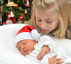 She whispered.... (PentlandPirate of the North) Tags: baby christmas santaclaus hat grandchildren sister ~flickrinnes flickrinnes