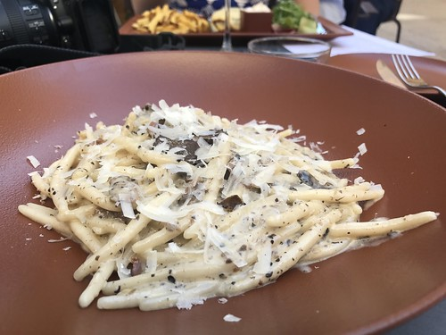 Fresh rustic pasta with black truffles and proscuitto