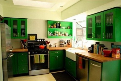 green-kitchen-cabinet-manufacturers-white-quartz-countertops-modern-ceiling-lamps-cream-tiles-back-stainless-steel-gas-stoves-old-teak-wooden-covers-593x397