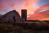 Sunset at the barn (Theresa Rasmussen) Tags: firstdayatchancellorsville firstdayatbattleofchancellorsville chancellorsvillebattlefield chancellorsville sunset barn haybales orange skies clouds pinkclouds