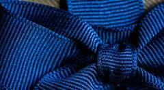 Ribbon of Blue (PhilR1000) Tags: bow decoration chocolatebox blue gold ribbon macromondays buttonsandbows macro
