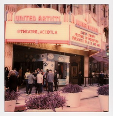 Disruption Marquee 3 (tobysx70) Tags: polaroid originals color 600 instant film slr680 frankenroid sx70 door rollers marquee festival of disruption the theatre at ace hotel broadway dtla los angeles la california ca neon sign illuminated lit united artists david lynch spanish gothic architecture 1927 movie theater cinema concert venue entrance people planters plants toby hancock photography