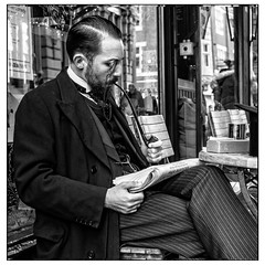 Remembrance Day tribute (Photos And All That) Tags: lincoln man pipe periodcostume traditional remembranceday street streetphotography period historical wingcollar frockcoat canon canon5dmarkii canoneos 5d 5dmarkii blackandwhite blackwhite monochromatic monochrome monochromes border photoborder whitephotoborder cafe cafes table seated pinstripe pinstripes waistcoat beard bearded linconshire lincs tribute remembrance war wars firstworldwar portrait portraits squareformat square monocle