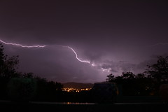 First attempt at a lightning photo (LachMH) Tags: sky night long exposure lightning storm rain lights city trees mountains clouds canon dark 700d t5i 1855mm first attempt new canberra act australia purple