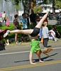 Acrobatic Maneuver (swong95765) Tags: girl female lady acrobatic flip street road parade gymnastic