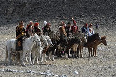 30101739 (wolfgangkaehler) Tags: 2017 asia asian centralasia mongolia mongolian westernmongolia ulgii ölgii bayanulgiiprovince altaimountains altaymountains altaymts goldeneaglefestival people person kazakh competing competition competitor kyzkhuar game games youth boys girls whipped horse horseriding horserace horseback horsebackriding horsebackrider fun funny traditionalgame