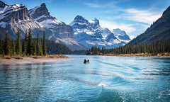 The Fisherman (Richard Davy - The World As I See It) Tags: lakemaligne canada boat canoe man trees tree forest wood mountains mountain sky cloud lake water waves hillside outdoor landscape jaspernationalpark jasper clouds alberta