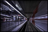Warp Speed (frankmartinroth) Tags: 35mm f20 sony rx1r sonnart235 building indoor wide urban geometry lines germany subway people blur speed movement city train rails color red underground motion
