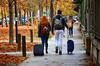 Ho l'autunno in testa (encantadissima) Tags: torino piemonte streetphotography capellirossi girl boy trolley fogliemorte viale alberi autunno