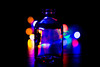 Bottled It (323/365) (iratebadger) Tags: nikon nikond7100 d7100 dark shadows colours colors indoors bokeh blur blue orange red yellow green bottle glass fairylights black iratebadger project365